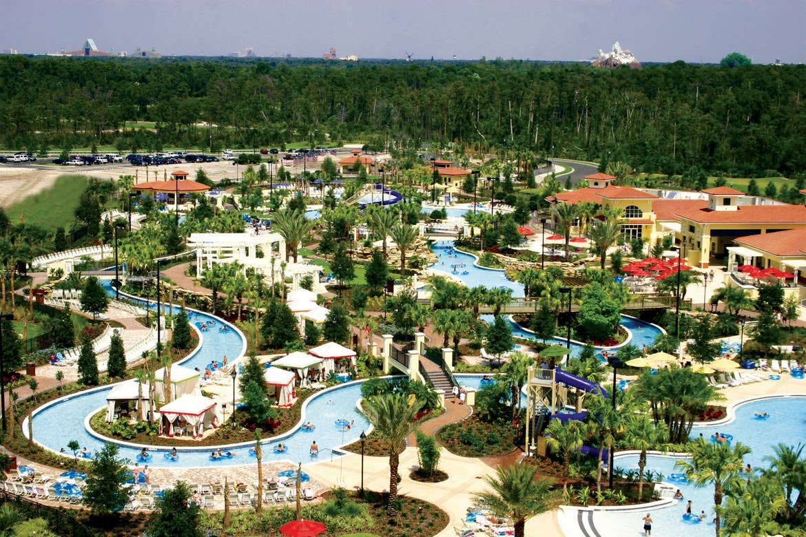 An aerial view of River Island at our Orange Lake Resort in Orlando, FL with the peak of Expedition Everest at Disney's Animal Kingdom Theme Park (top-right).