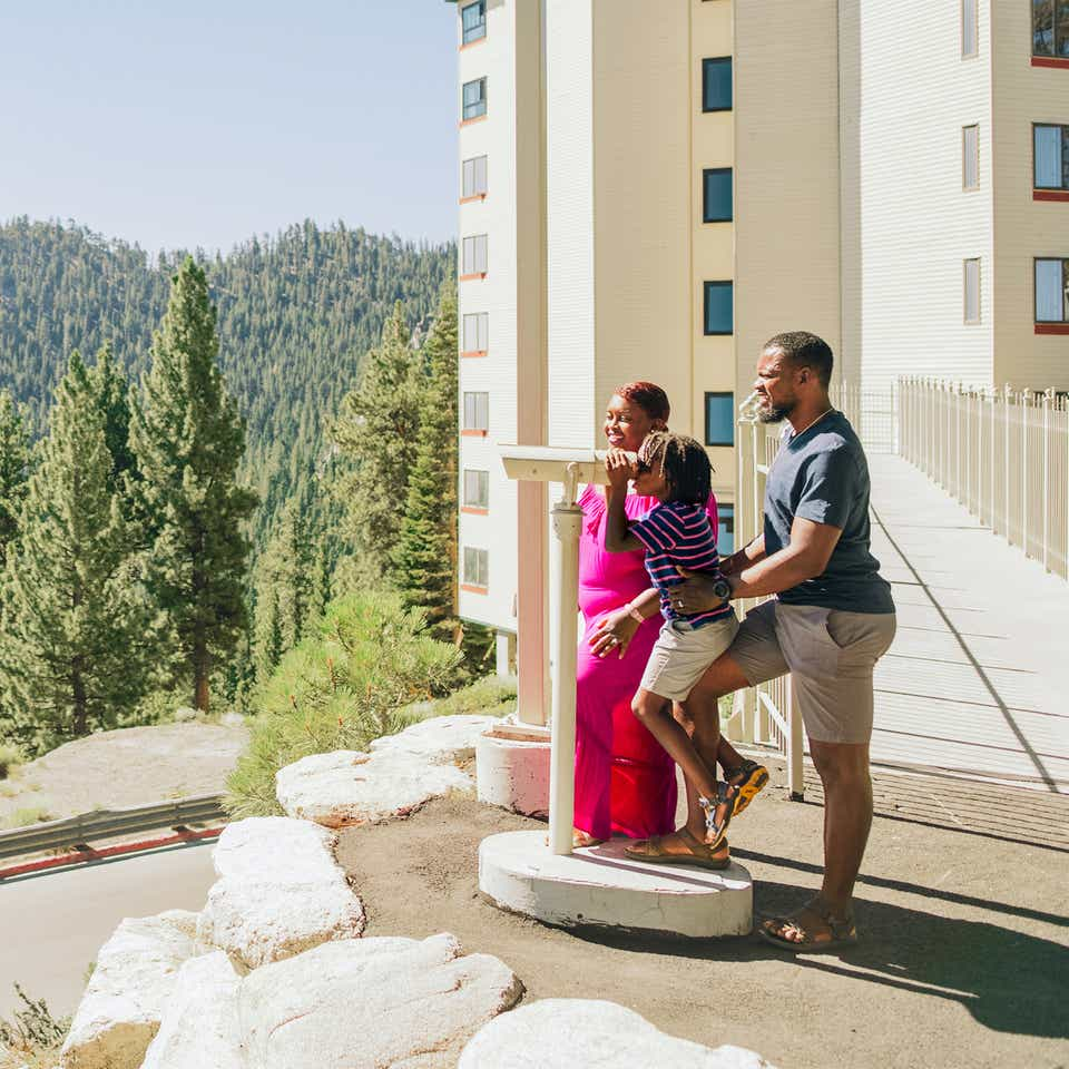 a family overlooking Lake Tahoe