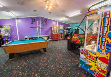 Arcade with pool table, arcade games and air hockey at Holly Lake Resort in Holly Lake Ranch, Texas.