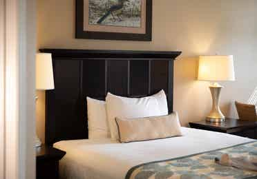 Bed and two nightstands in a villa in East Village at Orange Lake Resort near Orlando, Florida