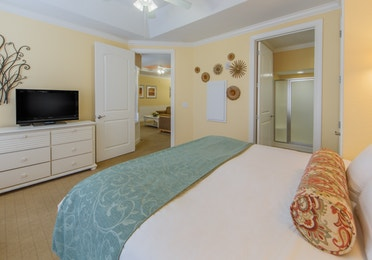 Bedroom in a two-bedroom presidential villa with a view of the bathroom at Apple Mountain Resort in Clarkesville, GA