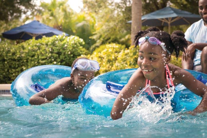 Young kids playing in lazy river at Orange Lake Resort near Orlando, Florida