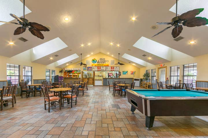 Activities Room with pool table, seating, and Grille at Hill Country Resort in Canyon Lake, Texas
