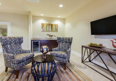 Lobby with comfortable seating and flat screen TV at Fox River Resort in Sheridan, Illinois