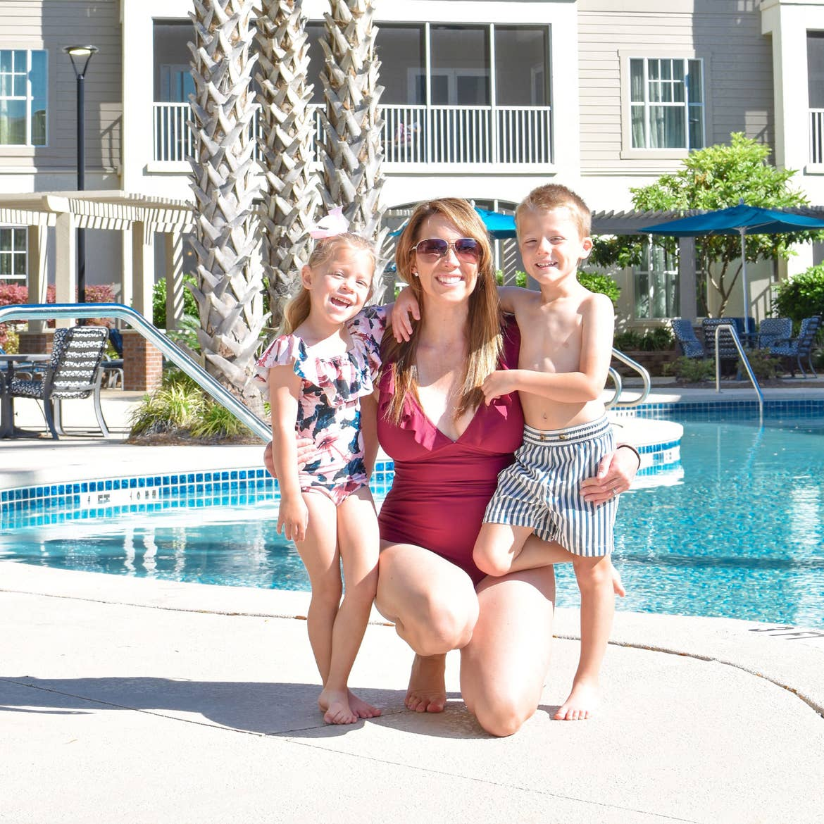 Featured Contributor, Brianna Steele (middle) stands with her children near the pool at our South Beach resort in Myrtle Beach, SC.