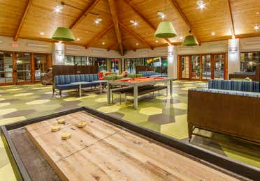 Game room at Scottsdale Resort in Arizona with table-top shuffleboard and a pool table