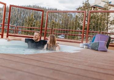 Couple sitting in outdoor hot tub at Tahoe Ridge Resort in Stateline, NV.
