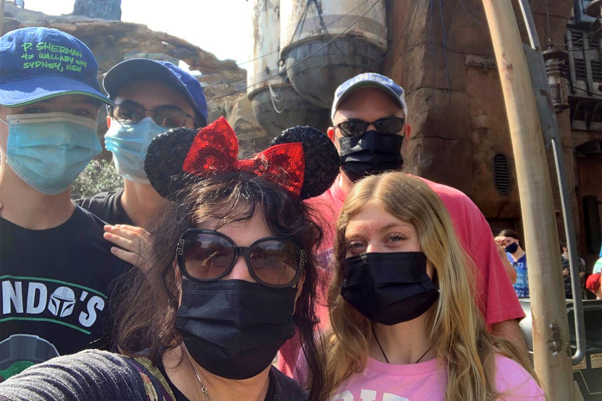 Featured contributor, Jenn Probst (front-middle) and her husband (back-right), two sons (back-left) and niece (front-right) wear masks and Disney based apparel at Galaxy's Edge in Disney's Hollywood Studios at Walt Disney World Resort.