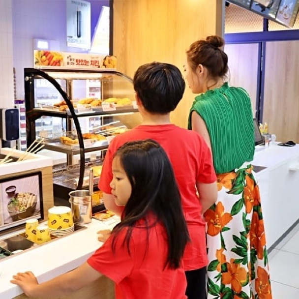 A young family shop at the bakery display section of a 7-Eleven in Seoul, South Korea.