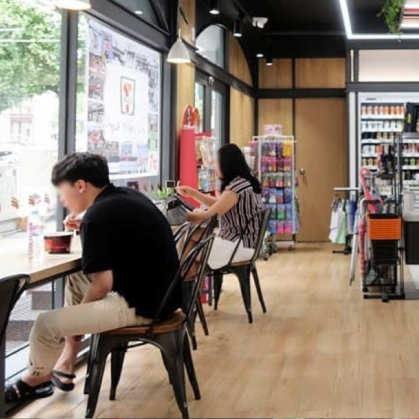 The cafe-style seating for customers at a 7-Eleven in Seoul, South Korea.