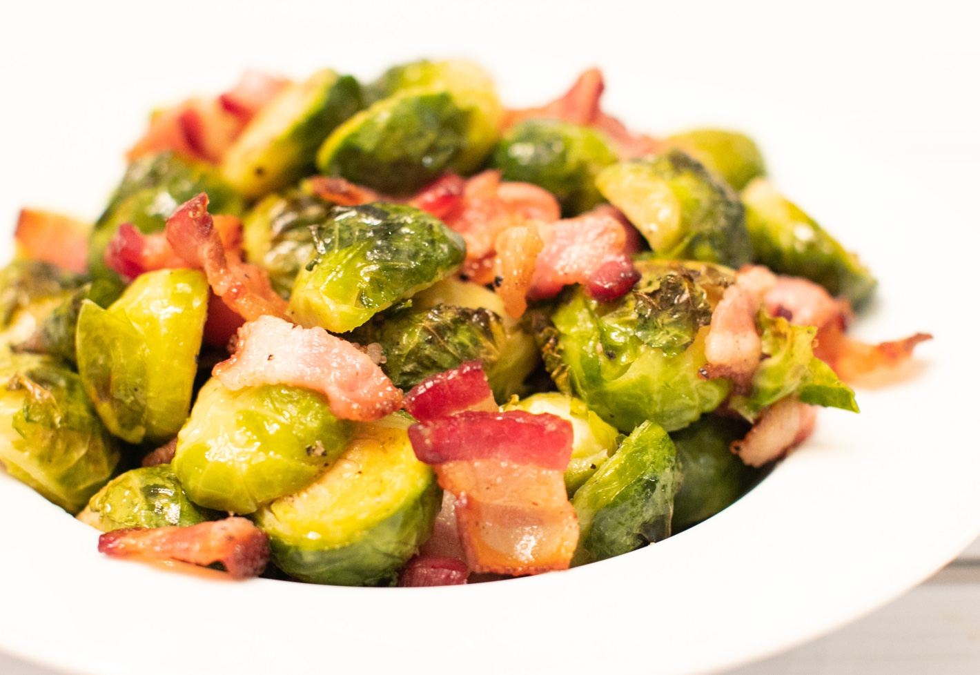 (Mostly) Bacon brussel sprouts, bacon and brussel sprouts dish in a white serving bowl.