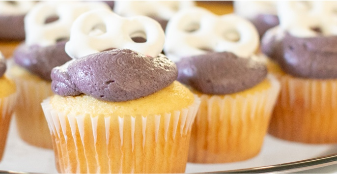 7-Eleven Cold-Pressed Cupcakes with frosting and yoghurt pretzel garnish.