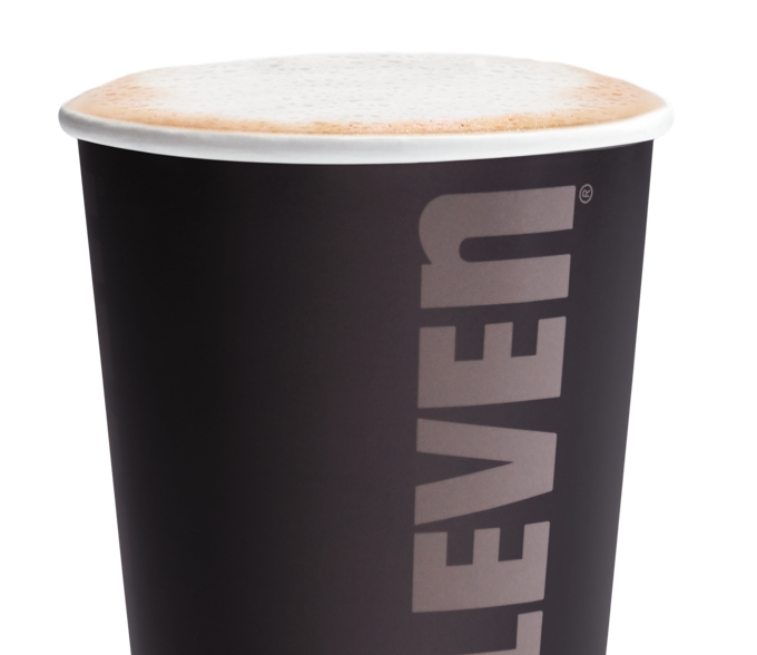 A close up of a hot blueberry cream latte in a 7-Eleven to-go cup.