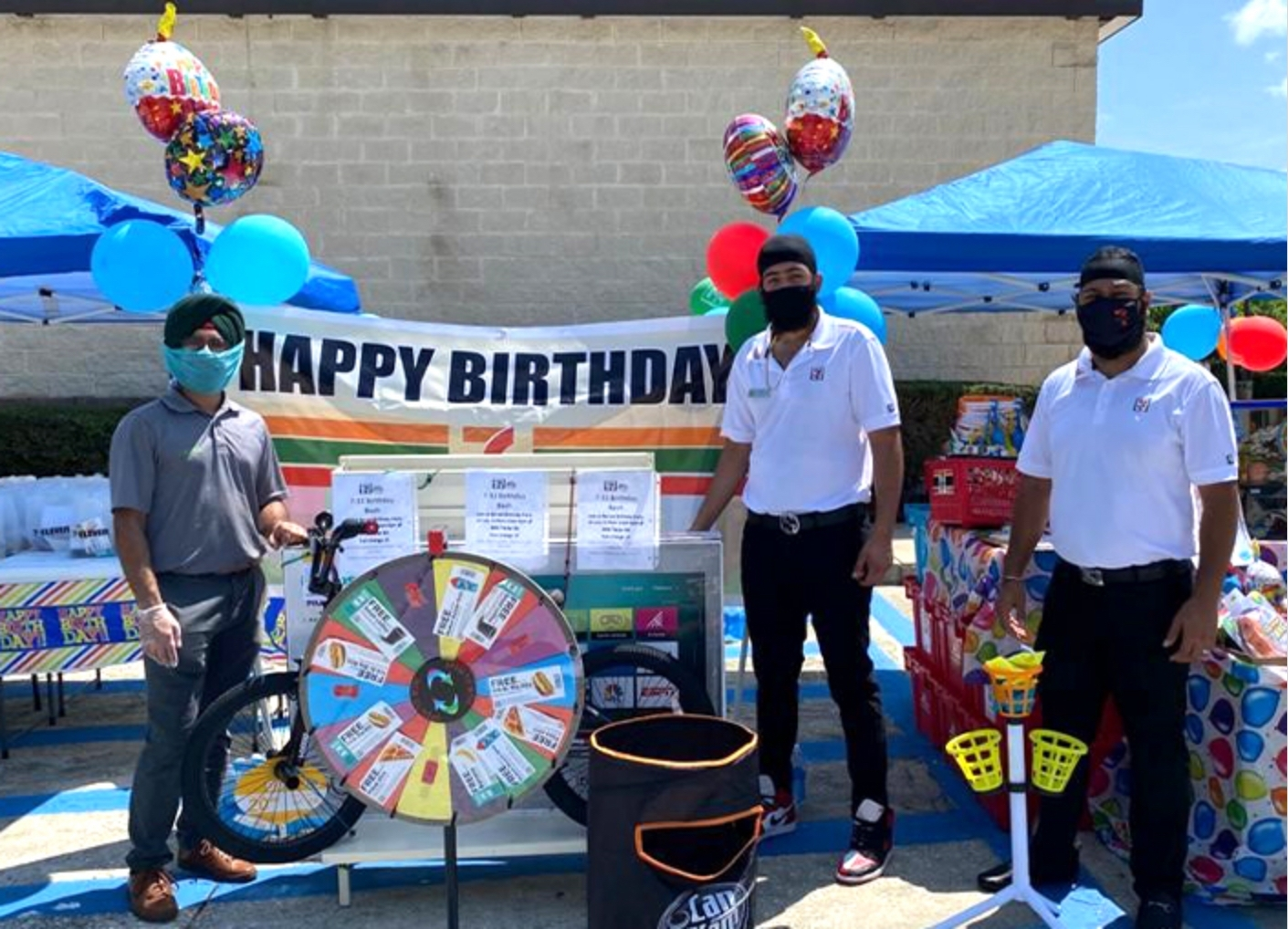 """Florida franchisee Sukaran """"Kevin"""" Singh with two employees members at a special community event."""