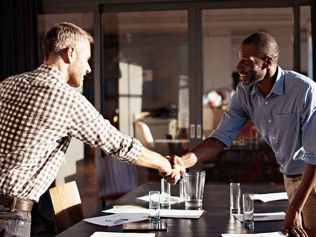 Men shaking hands during a negotiation