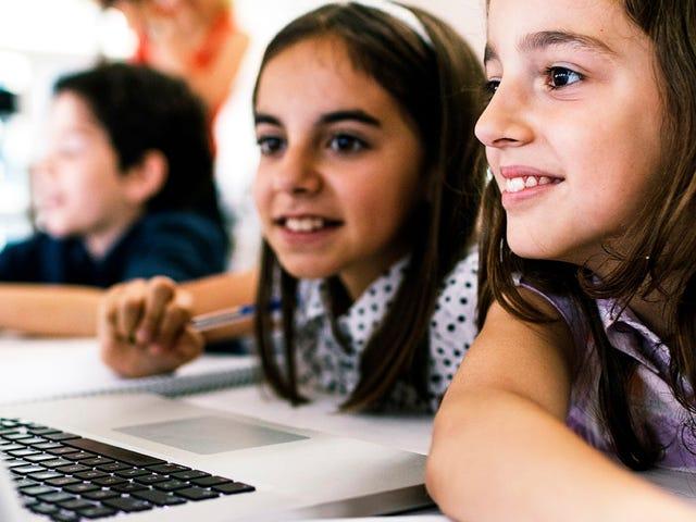 kids attending a language course on a laptop