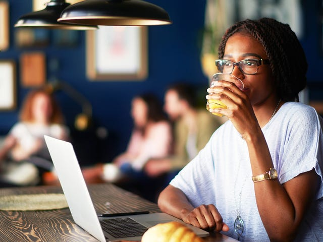 Woman attending an online private lesson on her laptop