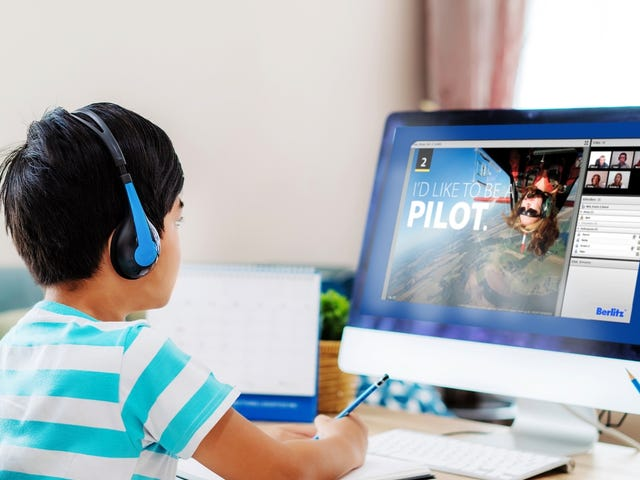 kid attending an online language course on his computer