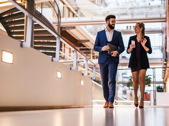 two people walking and giving constructive feedback
