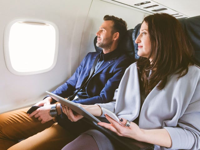 two people taking an intercultural training during a flight