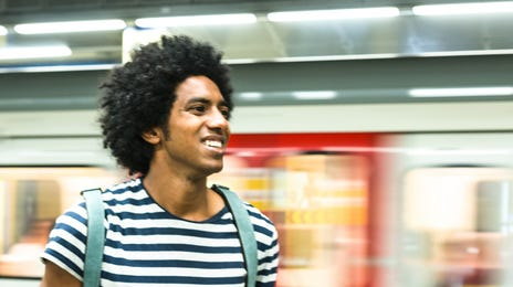 guy walking in a subway station
