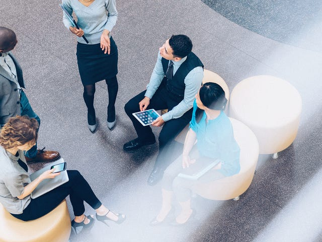 group of people in a meeting about business communication