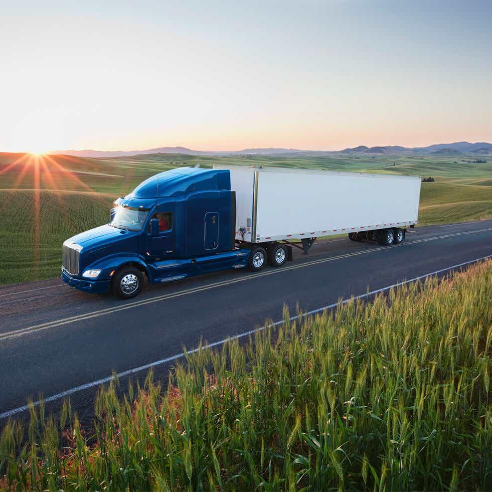 image of truck delivering timely agricultural deliveries