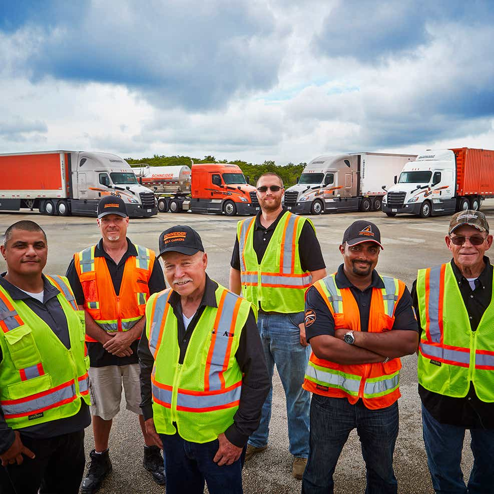 private fleet drivers standing in front of equipment