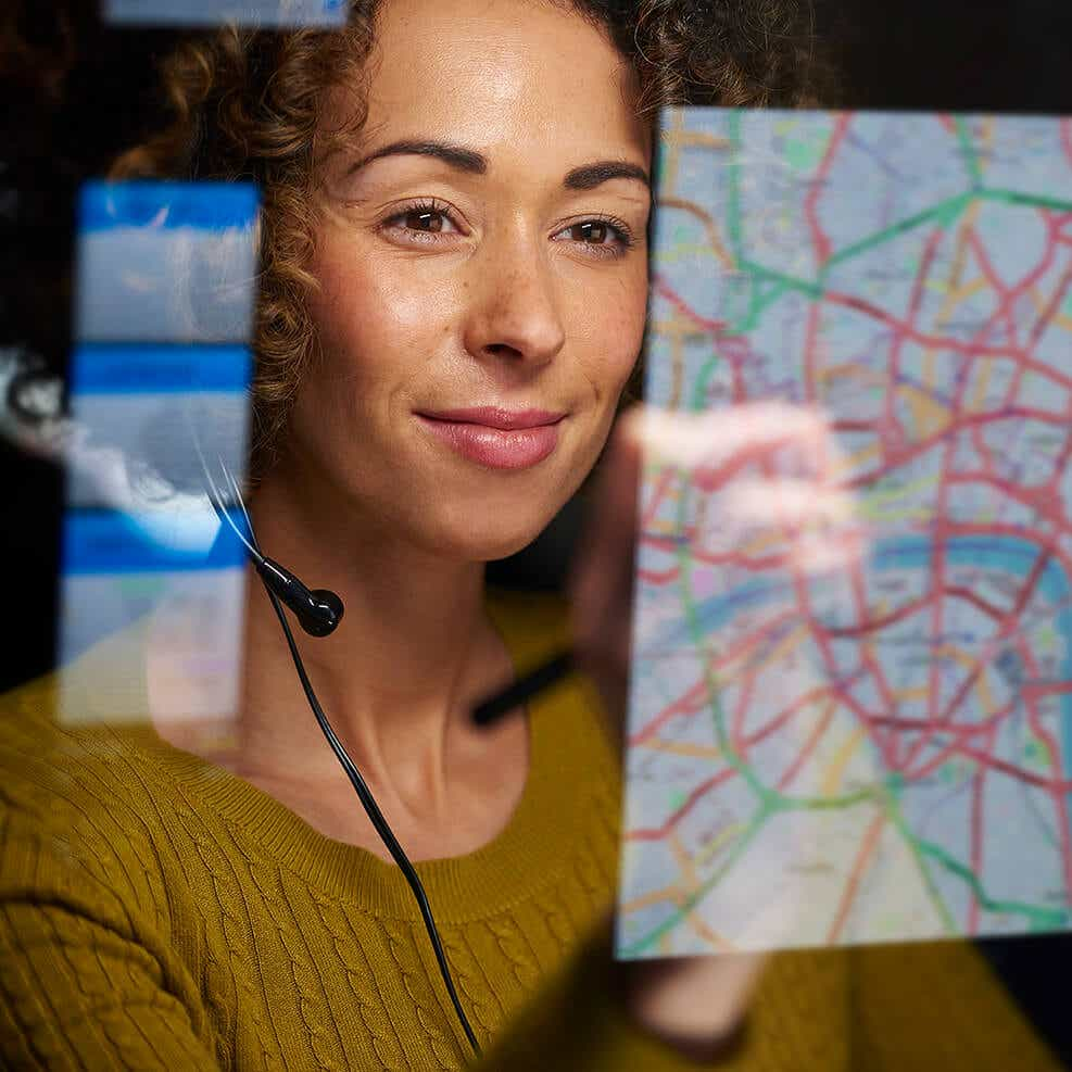 supply chain optimizations image woman reviewing delivery routes on screen