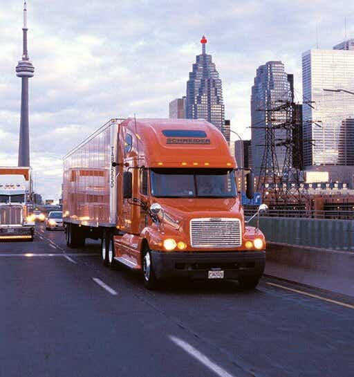 Cross-border transportation image of Schneider truck driving into Canada