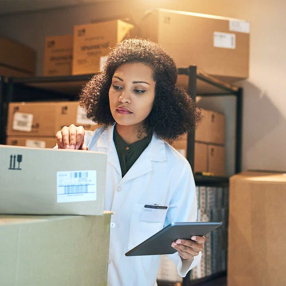 woman reviewing medical shipment