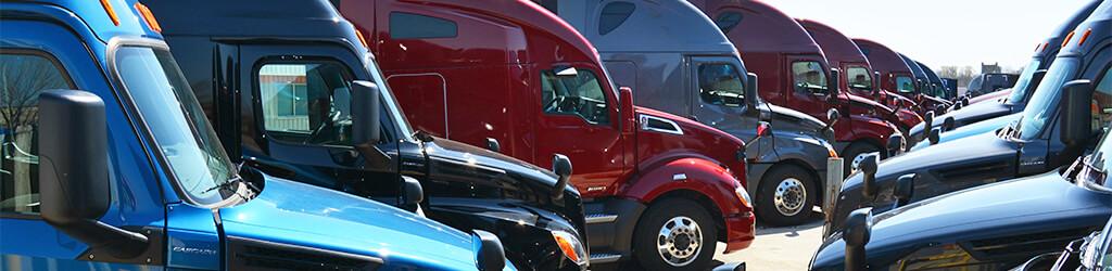 SFI semi trucks parked in a row