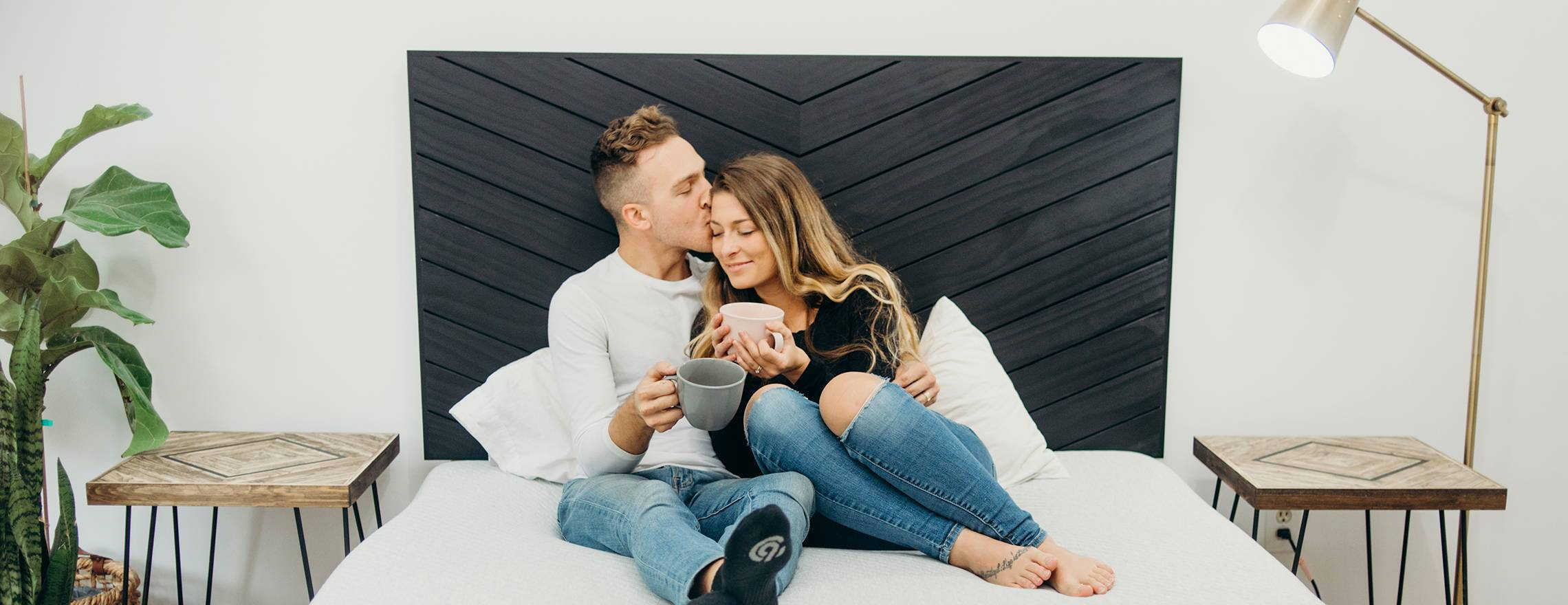 sweet_couple_on_a_leesa_mattress_with_coffee_1