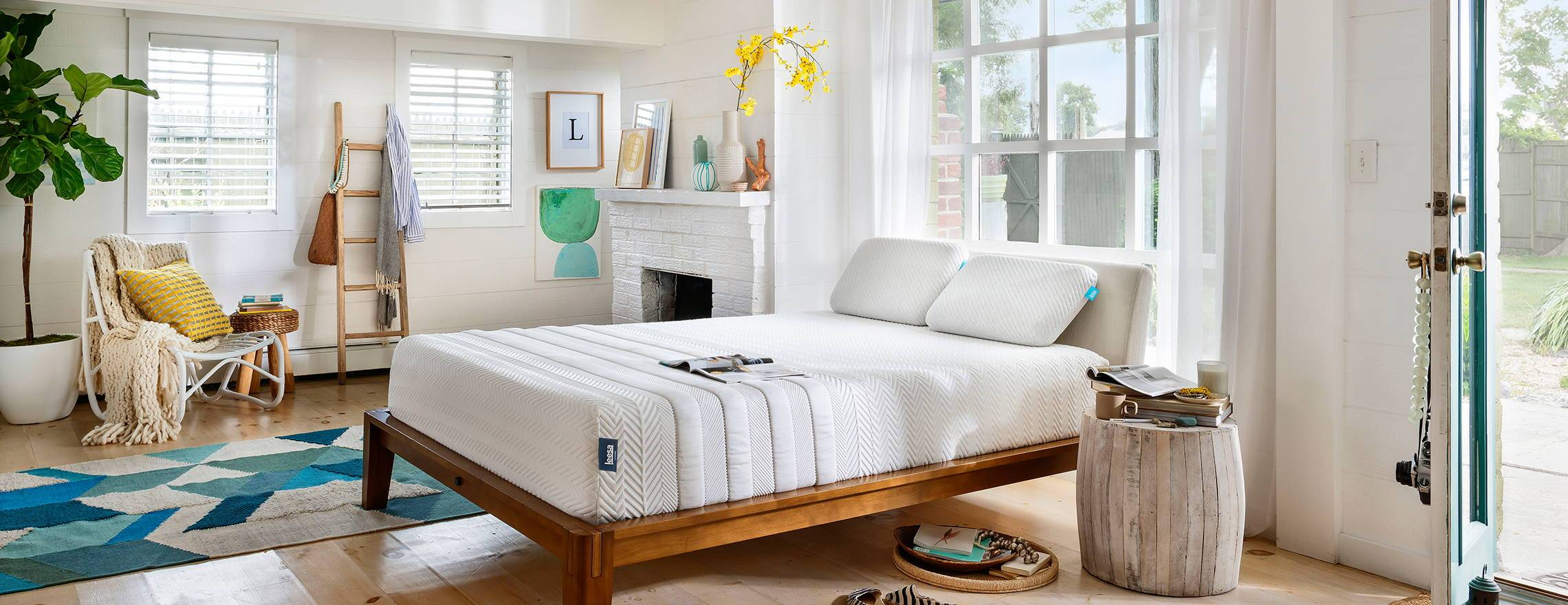 white_leesa_mattress_in_decorated_room_open_door_outside_view