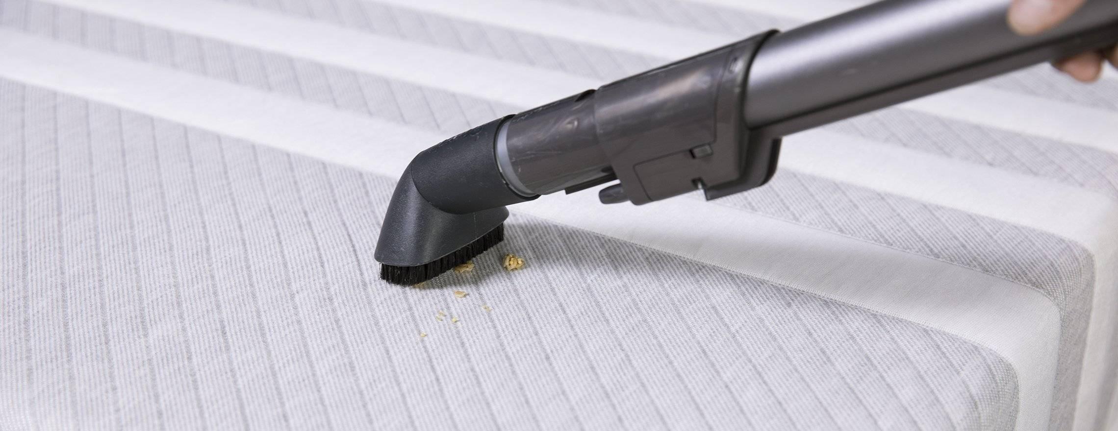 vacuuming_crumbs_off_a_mattress