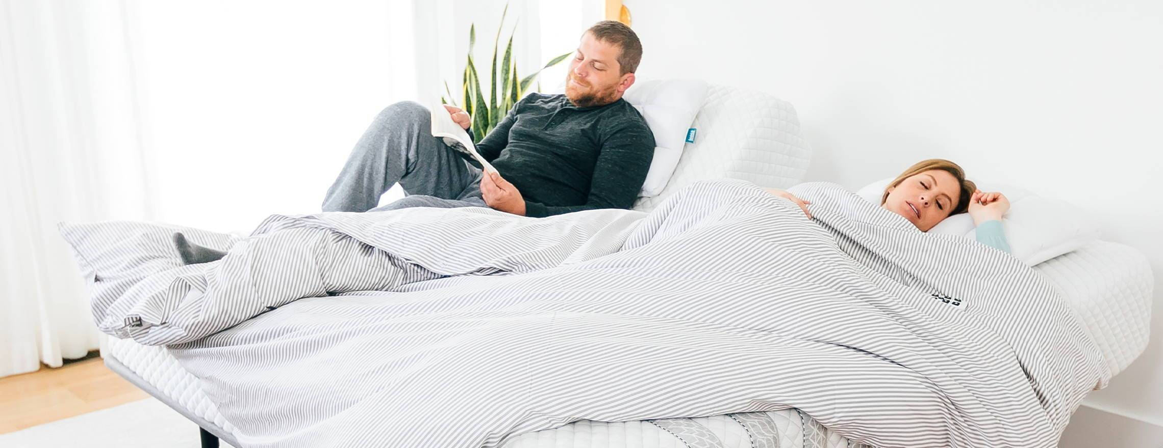 couple_in_a_leesa_king_mattress_sleeping_and_reading
