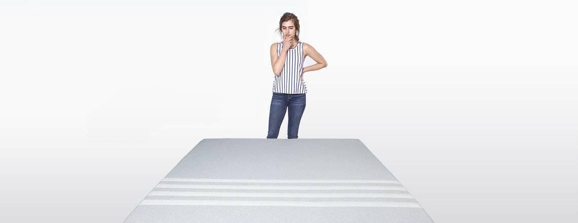 lady_standing_by_a_white_leesa_mattress_2