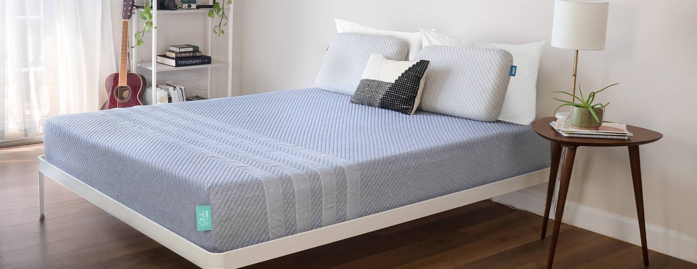 gray_leesa_mattress_with_pillows_in_decorated_bedroom