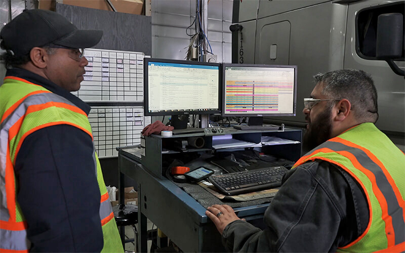Two diesel technicians use technology to find a solution to a problem.