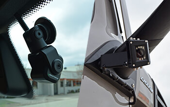 Two SmartDrive cameras are attached to the vehicle. The forward-facing camera is attached to the windshield of the new 2022 truck and the rear-facing camera is attached to the passenger side mirror of the truck. Both cameras do not face the driver.