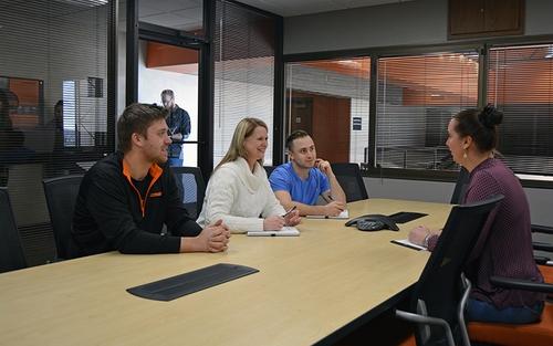 Three Schneider associates interview a job applicant.