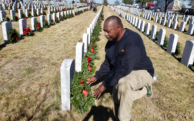 Randy Twine placing wreaths at soldiers' graves for Wreaths Across America