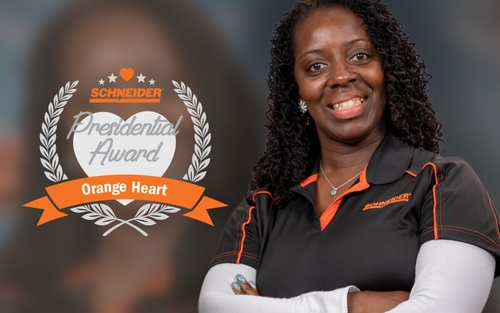 Schneider driver Latanya Smith poses after winning the Orange Heart Award.