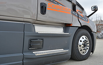A sensor is attached to the passenger side of the 2022 Freightliner Cascadia to detect lane departure.