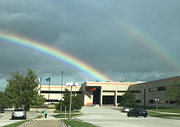Day in the life of a Schneider Facilities & Security Career - beautiful picture of a rainbow over schneider's green bay office