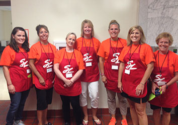 Schneider's Women's Network working hard at the Back to School Store in Green Bay!