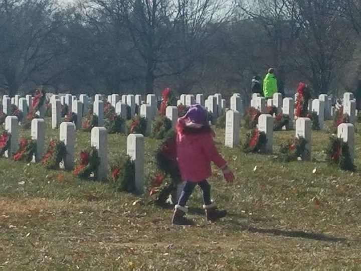 children laying wreaths for wreaths across america