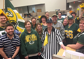 Customer Service Associates Dress Up in Packers Gear for the Game