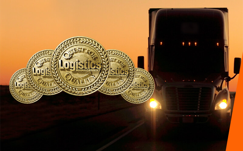 Five gold badges representing Schneider's five Quest for Quality awards in front of a semi-truck in a sunset.