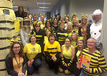 Schneider's Global Operations team dresses as a beehive for Halloween.